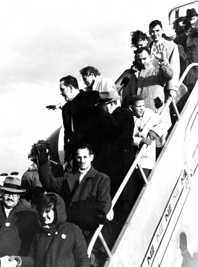Cuban refugees arriving at Logan Airport in 1962, some of the thousands who fled following the 1959 revolution led by Fidel Castro. Courtesy of the Boston Globe.