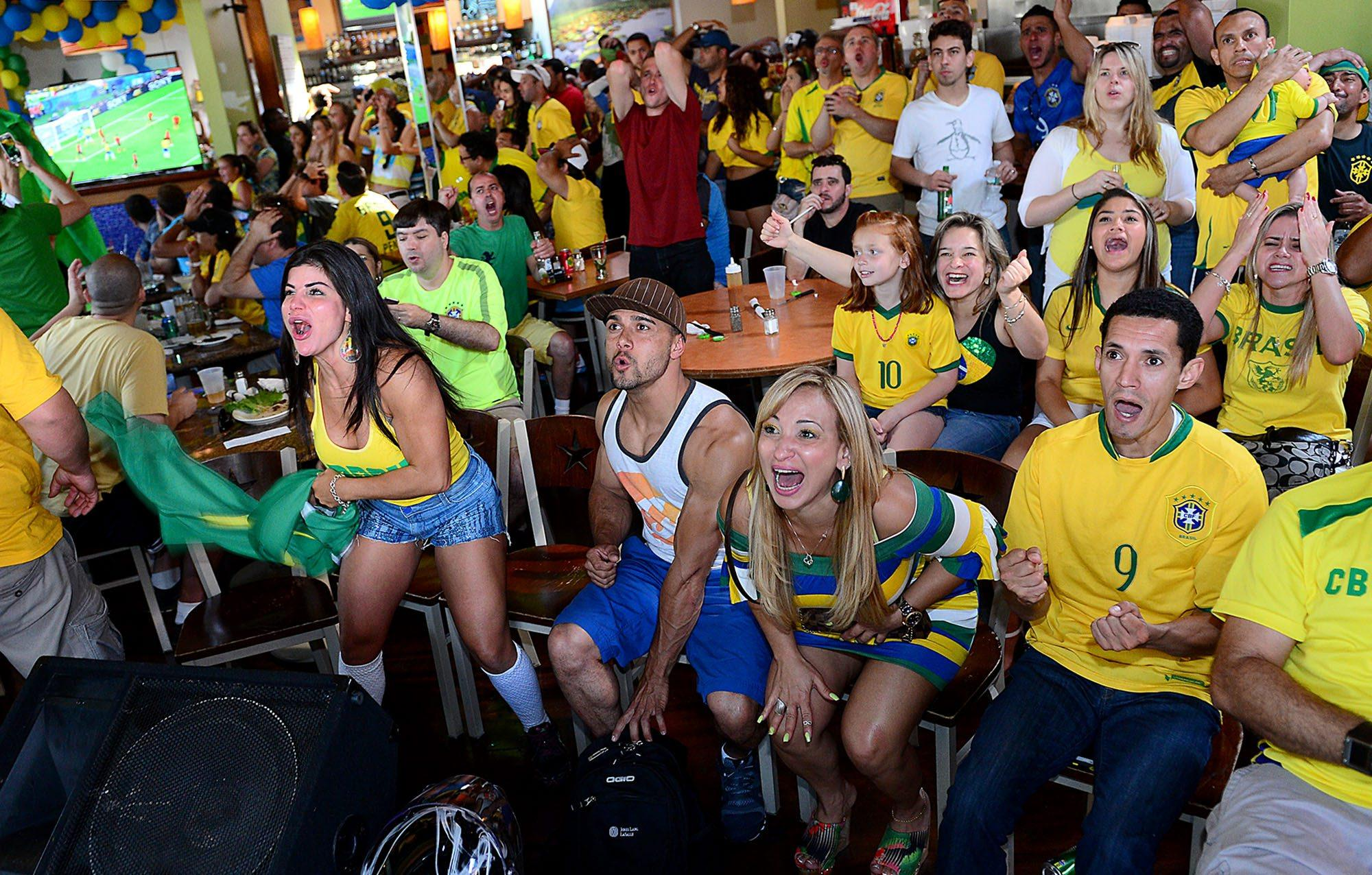 Brazilian Fans Watching The World Cup Playoffs In The Tropical Cafe In Framingham, 2014. Courtesy Of The Milford Daily News.
