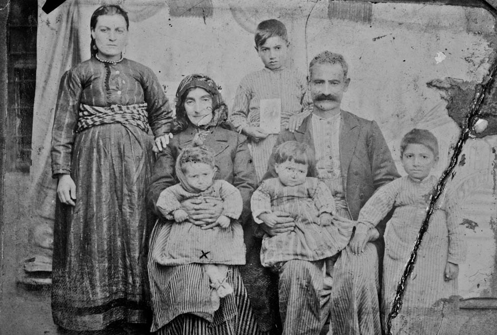 Khachadoor Pilibosian In A Family Photo. He Is Seated On His Mothers Lap. Project SAVE Armenian Photograph Archives, Watertown, MA.