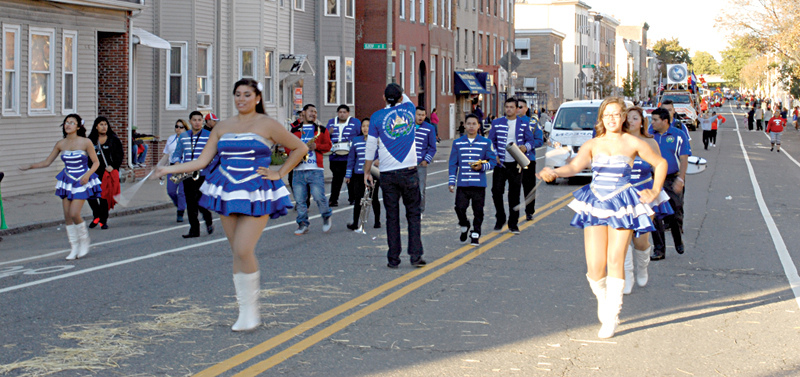 "Boston Banda De Paz, A Salvadoran ""peace"" Band, Marches In East Boston, 2014. Courtesy Of El Planeta."