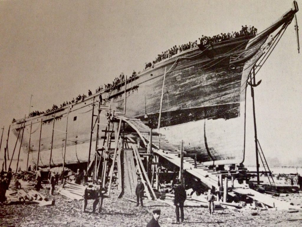 Launching of the Glory of the Sea from Donald McKay's shipyard on Border Street, 1869.