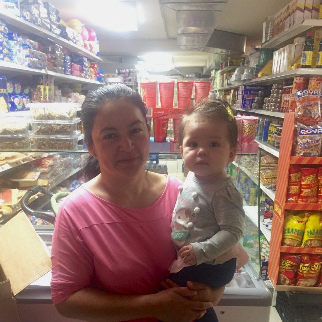 Deysi Martinez and her daughter at her business, Estrellita Food Market.